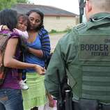 JUNE 25, 2014, 5:05 PM, GRANJENO, TEXAS Ð An infant cries as U.S. Border Patrol agents process a group of immigrants in Granjeno, Texas. The city is just north of  ÒEl Rincon del Diablo,Ó the DevilÕs Corner, a hotbed of illegal border crossing on the Rio Grande by juvenile and mothers with children immigrants from Central America.