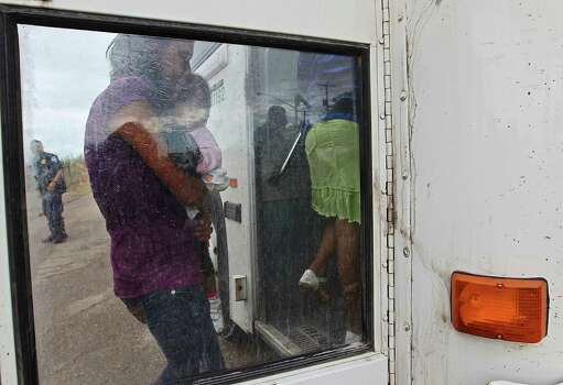 "JUNE 25, 2014, 5:04 PM, GRANJENO, TEXAS – After processed by Border Patrol agents, immigrants board a U.S. Government bus in Granjeno, Texas. The city is just north of  ""El Rincon del Diablo,"" the Devil's Corner, a hotbed of illegal border crossing on the Rio Grande by juvenile and mothers with children immigrants from Central America. Photo: Jerry Lara, San Antonio Express-News / ©2014 San Antonio Express-News"