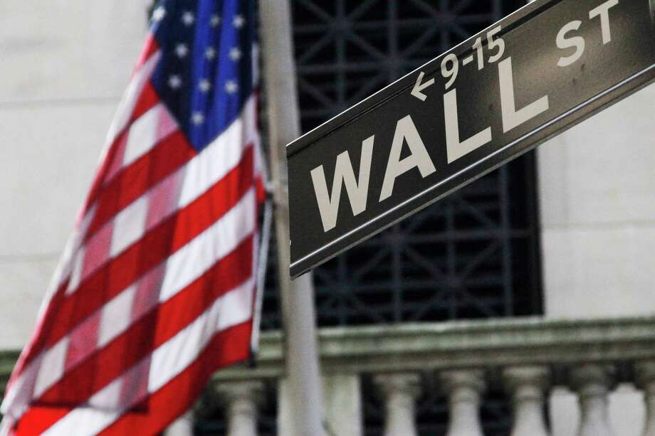 FILE - This Monday, July 15, 2013 file photo shows the American flag and Wall St. street sign outside the New York Stock Exchange, in New York. Asian stocks slumped Friday, June 27, 2014, after a reports showed weak U.S. consumer spending and slowing Chinese industrial profit growth, casting doubts on whether the world's two biggest economies can rebound. (AP Photo/Mark Lennihan, File) ORG XMIT: NYBZ126 Photo: Mark Lennihan / AP