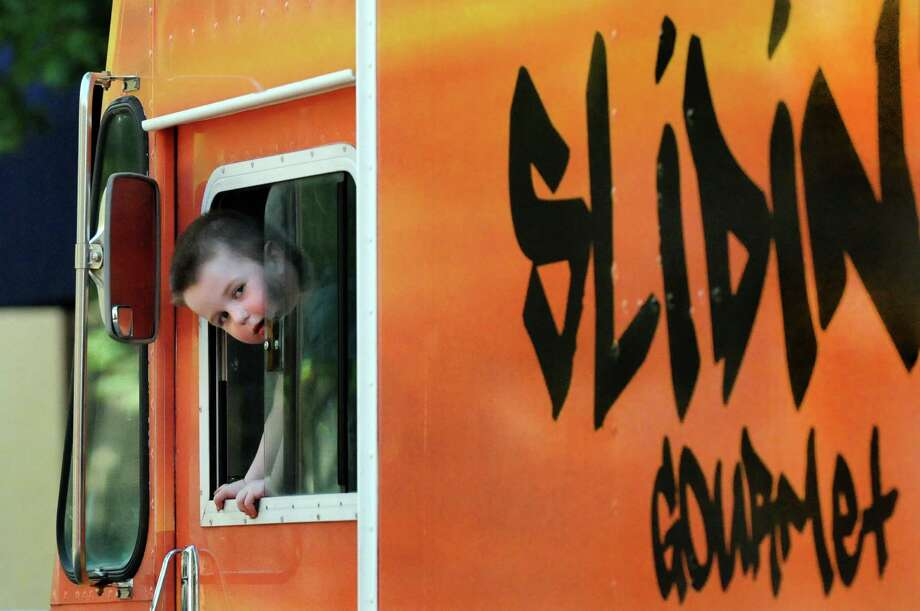 Ryan Taney, 3, looks out from the Slidin' Dirty food truck on Friday, June 27, 2014, in Troy, N.Y. His parents, Tim and Brooke Taney, will turn their mobile food business into a restaurant on the first floor of 9 First St. (Cindy Schultz / Times Union) Photo: Cindy Schultz / 00027531A