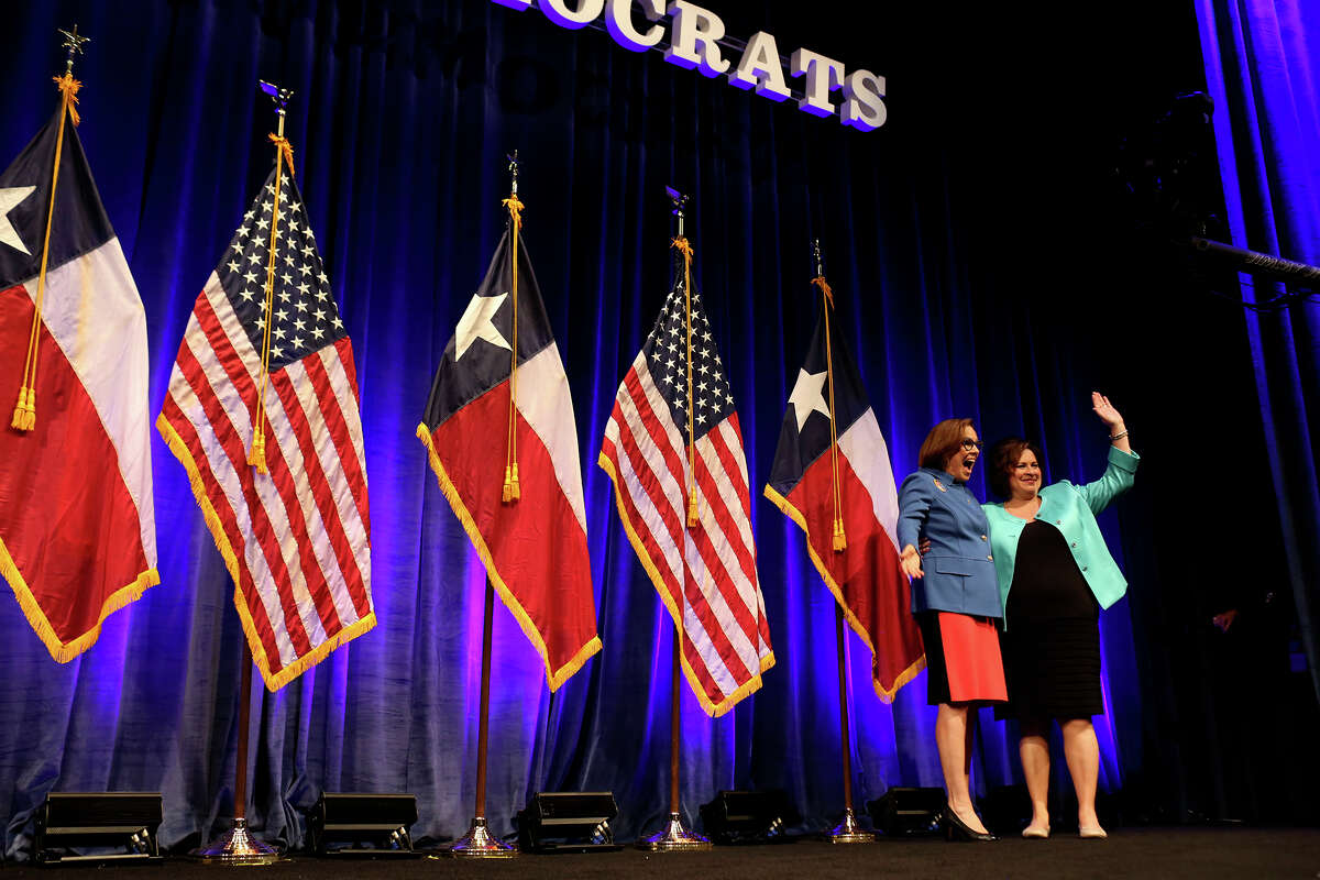 State Senator and candidate for Lt. Governor Leticia Van de Putte, right, is introduced by Annie's List Interim Executive Director Patsy Woods Martin to speak to the Women's Caucus during the Texas Democratic State Convention at the Dallas Convention Center in Dallas on Friday, June 27, 2014.