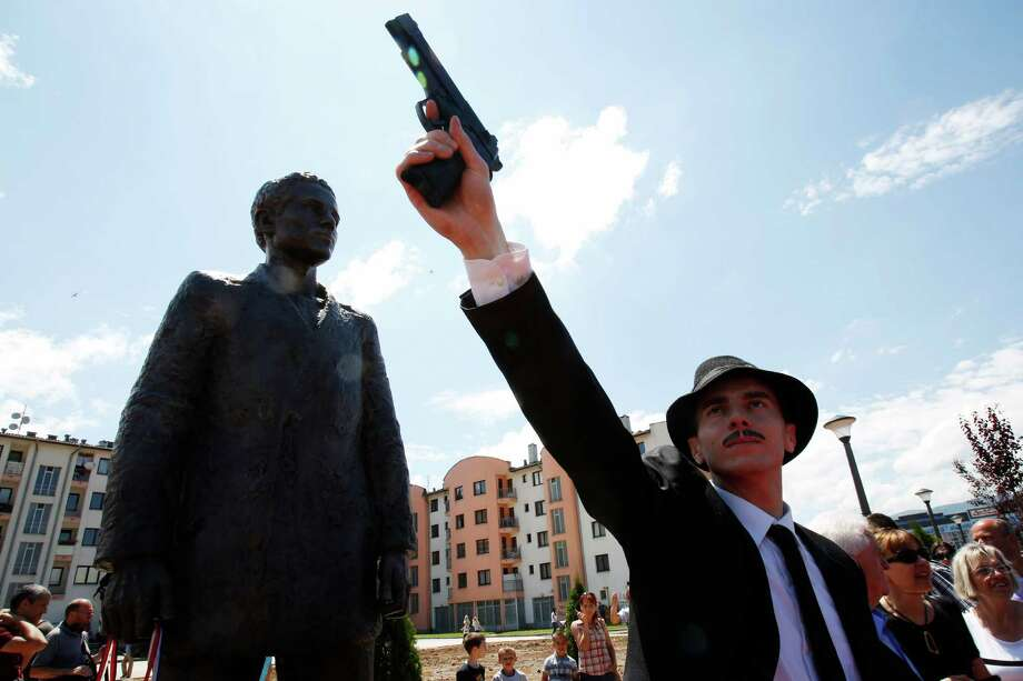 Bosnian actor Jovan Mojsilovic poses with a plastic replica gun  during ceremony of unveiling statue of Gavrilo Princip in Istocno Sarajevo, on Friday, June 27, 2014. Marking the centennial of the beginning of World War I in their own way, Bosnian Serbs have unveiled a monument of Gavrilo Princip in the Eastern part of Sarajevo to the man who ignited the war by assassinating the Austro-Hungarian crown prince on June 28, 1914.(AP Photo/Amel Emric) Photo: Amel Emric, STR / AP