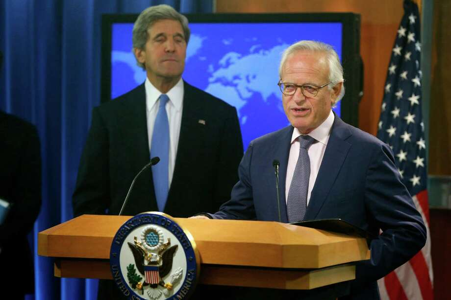 FILE - This July 29, 2013 file photo shows Secretary of State John Kerry listening as Martin Indyk speaks at the State Department in Washington. U.S. special Mideast envoy Martin Indyk is resigning after nearly a year of unsuccessful efforts to forge an Israeli-Palestinian peace deal, Obama administration officials said Friday.  (AP Photo/Charles Dharapak, File) Photo: Charles Dharapak, STF / AP