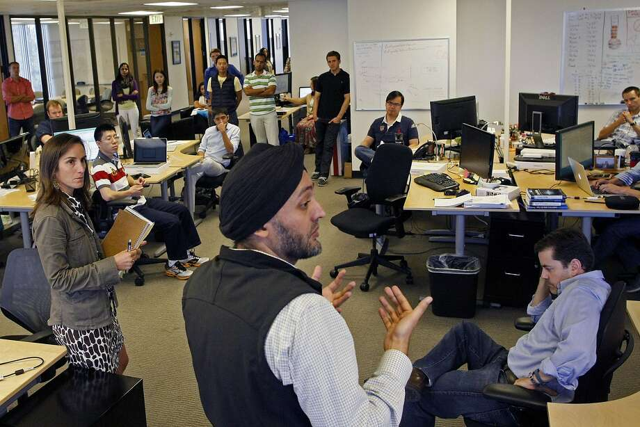 CEO Hardeep Walia addresses Motif employees in San Mateo. The company can disrupt traditional brokerages. Photo: James Tensuan, The Chronicle