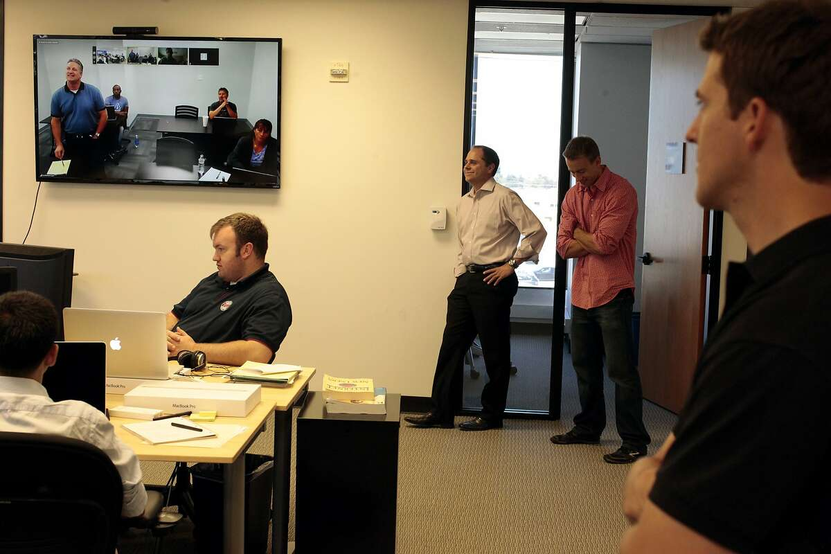 Employees of Motif are updated their co-workers on screen from the Sacramento office as they have their afternoon meeting in San Mateo, Calif. on Friday, June 27, 2014. Motif allows small investors to cheaply invest in motifs or themes. in San Mateo, Calif. on Friday, June 27, 2014. Motif allows small investors to cheaply invest in motifs or themes.