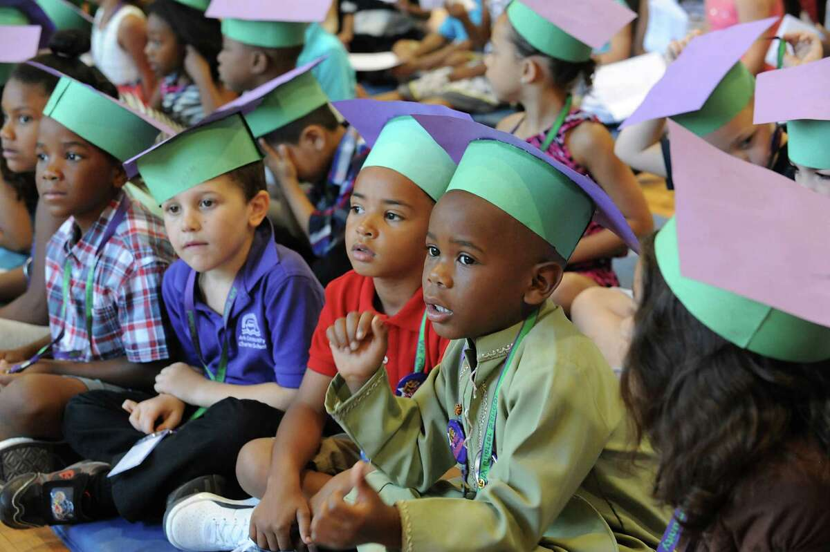 Kindergarten students listen to a speaker during the annual Moving Up Ceremony at the Ark Community Charter School Friday, June 27, 2014 in Troy, N.Y. The charter school has been targeted for closure. (Lori Van Buren / Times Union)