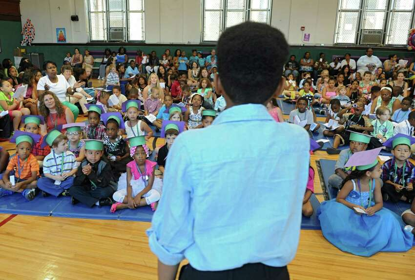 Fourth-grade graduate Kieshawn Kemp, 10, sings during the annual Moving Up Ceremony at the Ark Community Charter School Friday, June 27, 2014 in Troy, N.Y. The charter school has been targeted for closure. (Lori Van Buren / Times Union)