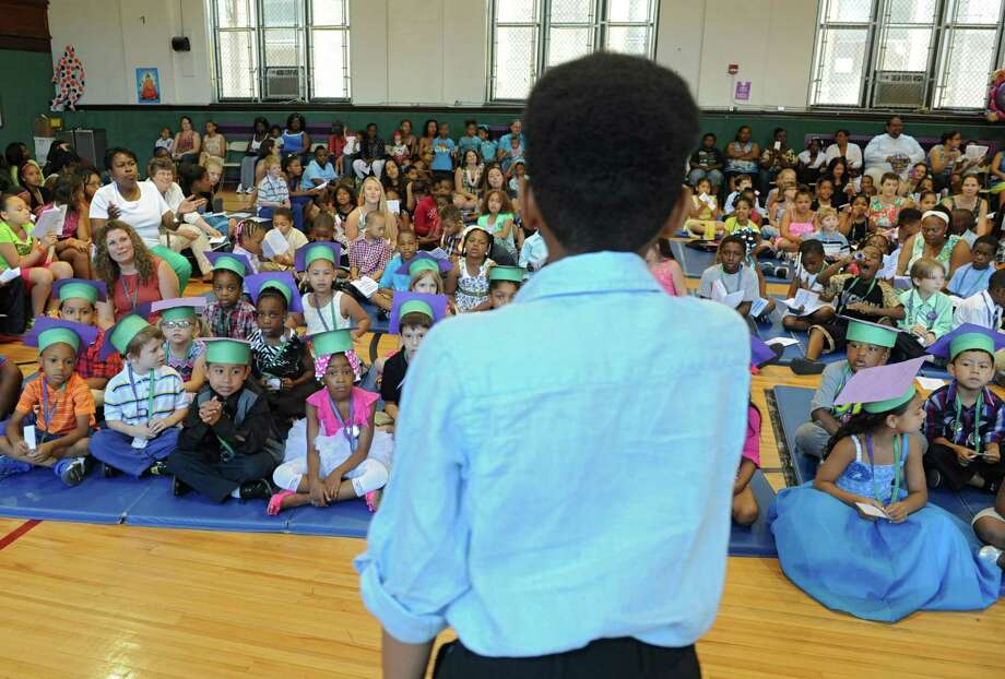 Fourth-grade graduate Kieshawn Kemp, 10, sings during the annual Moving Up Ceremony at the Ark Community Charter School Friday, June 27, 2014 in Troy, N.Y. The charter school has been targeted for closure. (Lori Van Buren / Times Union) Photo: Lori Van Buren / 00027545A