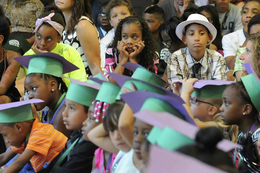 Students listen to a speaker during the annual Moving Up Ceremony at the Ark Community Charter School Friday, June 27, 2014 in Troy, N.Y. (Lori Van Buren / Times Union)