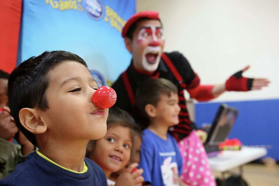 Edson Sorto wears his new clown nose gifted by the Ringling Bros. and Barnum & Bailey clown Rob Lok after his performance for the Chinese Community Center Youth Summer Camp on Friday, June 27, 2014, in Houston, Tx. Photo: Mayra Beltran, Houston Chronicle / © 2014 Houston Chronicle