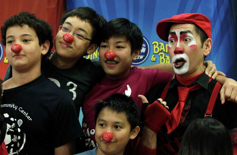 Adam Tefft, Alex Yany, Victor Tranpark, and Bowen Thi, pose for a photo with Ringling Bros. and Barnum & Bailey Clown Rob Lok after his performance at the Chinese Community Center on Friday, June 27, 2014, in Houston, Tx. Photo: Mayra Beltran, Houston Chronicle / © 2014 Houston Chronicle