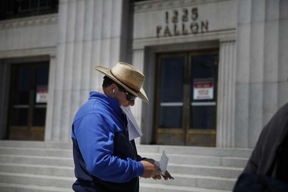 Greg Casorso, bidder for Community Fund LLC, stands at the Alameda County Courthouse during a trustee sale on Monday, April 28, 2014 in Oakland, Calif. Photo: Lea Suzuki, The Chronicle