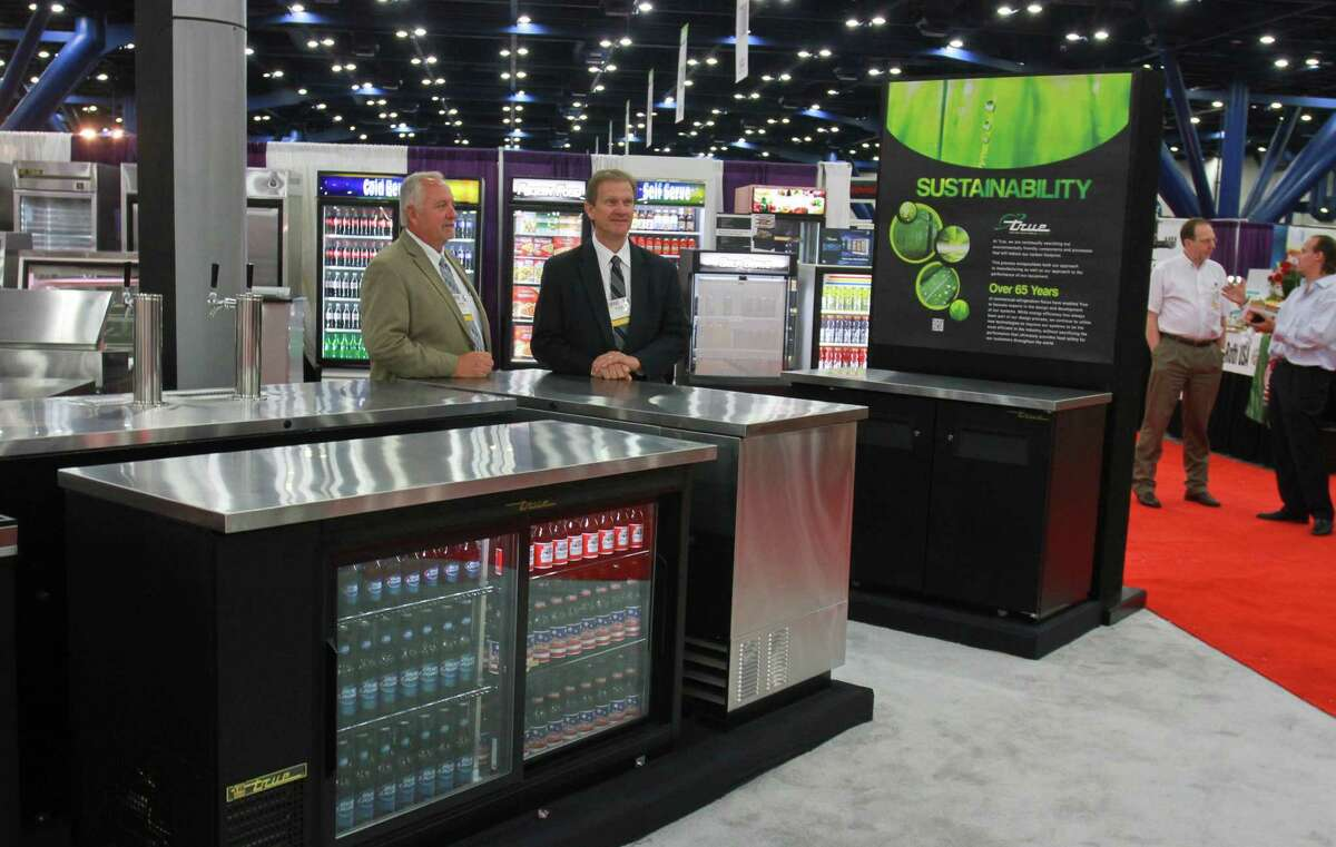 Kevin Clifton (left) and Randy Bates, both with True Food Service Equipment, showcase their products at the Texas Restaurant Association foodservice show.