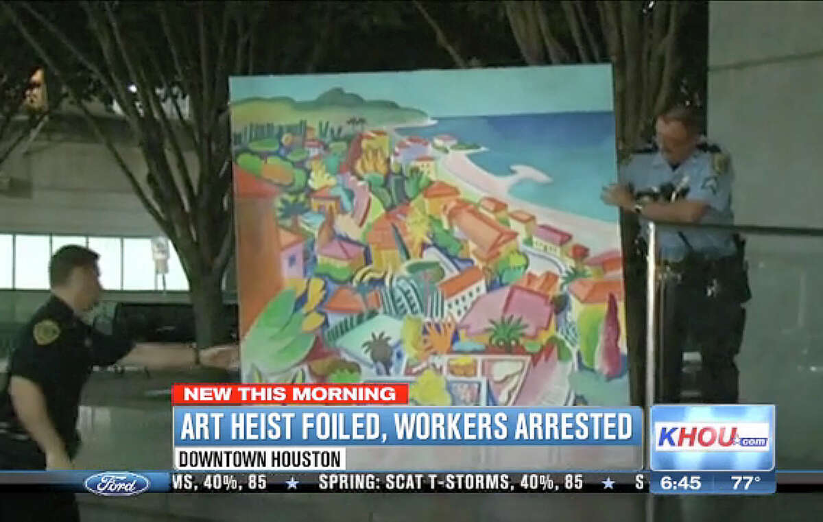 A video frame grab from KHOU Channel 11 shows the $18,000, 6-foot-by-6-foot painting that two men allegedly tried to steal. Security guards watched the attempted robbery and called the police.