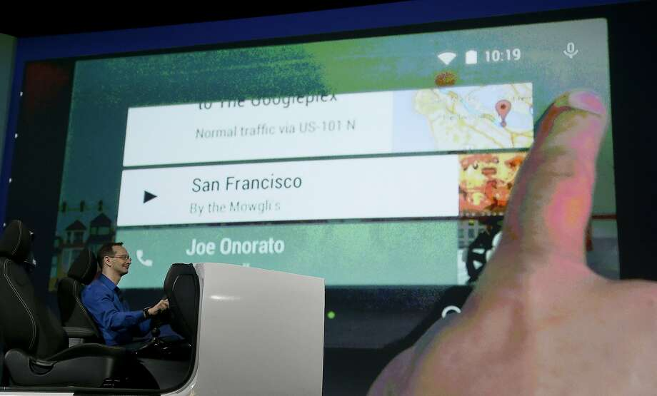 A demonstration of Android Auto is given during the Google I/O 2014 keynote presentation last week in San Francisco. Some are skeptical that it can be used safely. Photo: Jeff Chiu, Associated Press