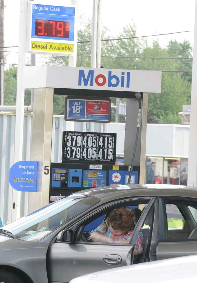 A woman gets in her car after pumping gas for $3.79 a gallon at a Mobil gas station on State St. on Monday, July 15, 2013 in Niskayuna, N.Y.  (Lori Van Buren / Times Union) Photo: Lori Van Buren / 00023170A