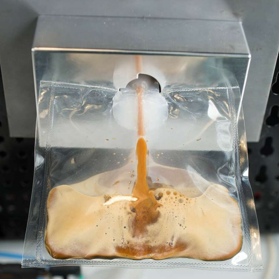 The ISSpresso machine will be the first real Italian espresso machine on the International Space Station, set to coincide with a six-month mission by the first Italian female astronaut, Samantha Cristoforetti. Photo: Uncredited, HONS / Lavazza
