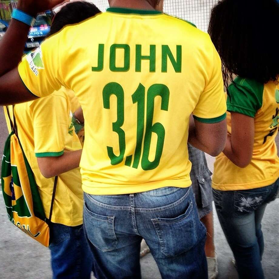 New soccer jersey number outside the stadium. John 3:16 from the bible, Rio de Janeiro. Photo: Wong Maye-E, Associated Press / AP