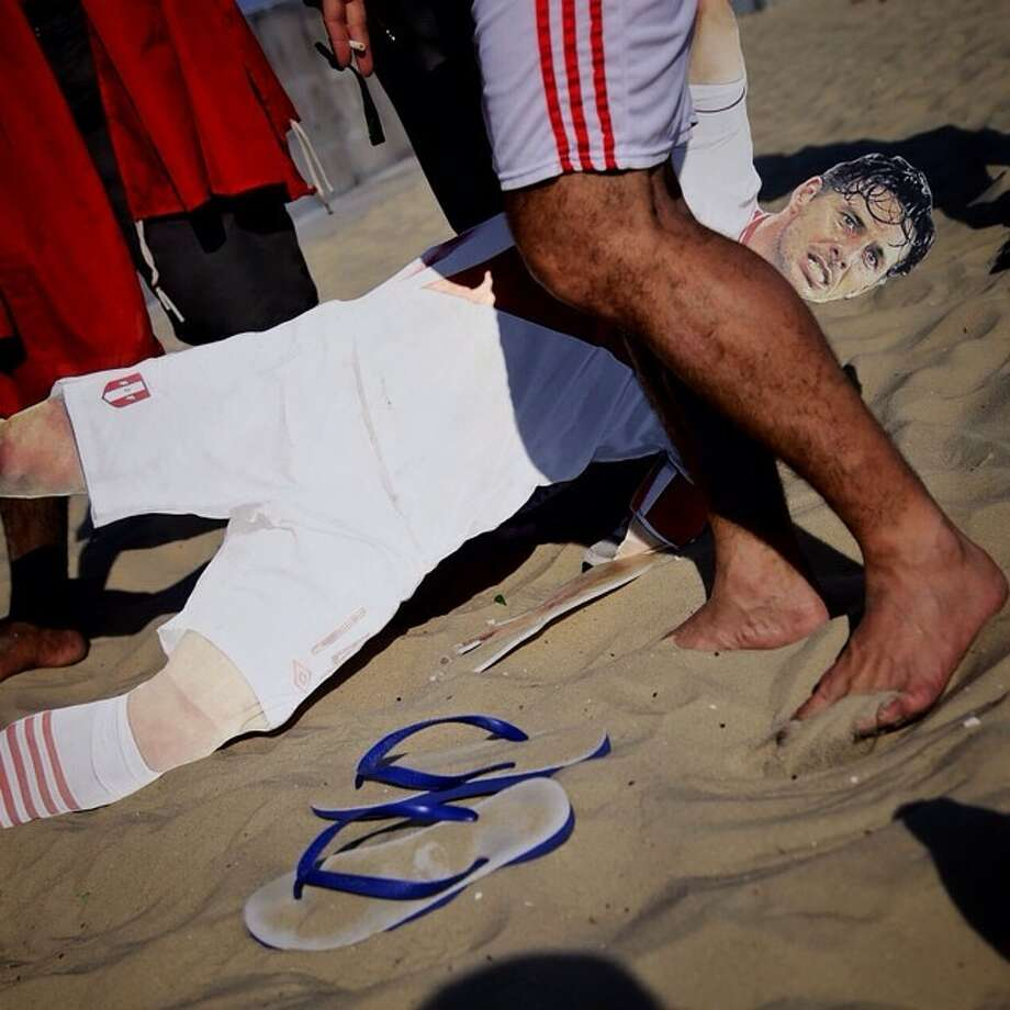 Fallen standee and soccer fans at Copacabana beach, Rio de Janeiro. Photo: Wong Maye-E, Associated Press / AP