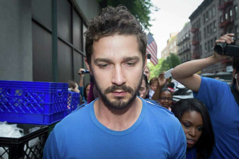 "Actor Shia LaBeouf is followed by media after leaving Midtown Community Court following his arrest the previous day for yelling obscenities at the Broadway show ""Cabaret,"" Friday, June 27, 2014, in New York. The 28-year-old star of the ""Transformers"" franchise faces charges that include disorderly conduct and criminal trespass.  (AP Photo/John Minchillo) Photo: John Minchillo, FRE / FR170537 AP"