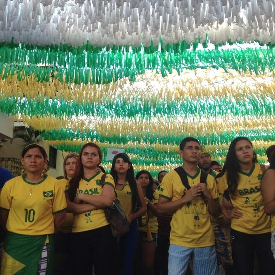 Brazilians watch their country play in a World Cup match in Manaus, Brazil. Photo: Marcio Jose Sanchez, Associated Press / AP