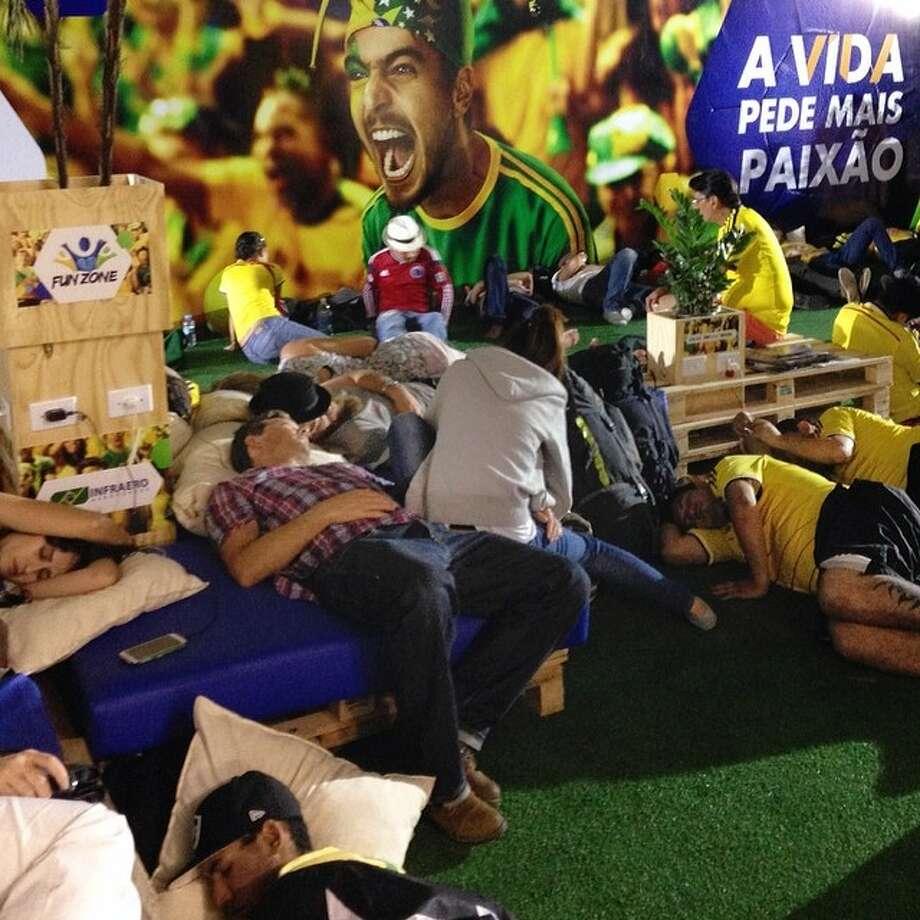 Soccer supporters at midnight in Cuiaba airport, Brazil. Photo: Shuji Kajiyama   A Colombian Sup, Associated Press / AP
