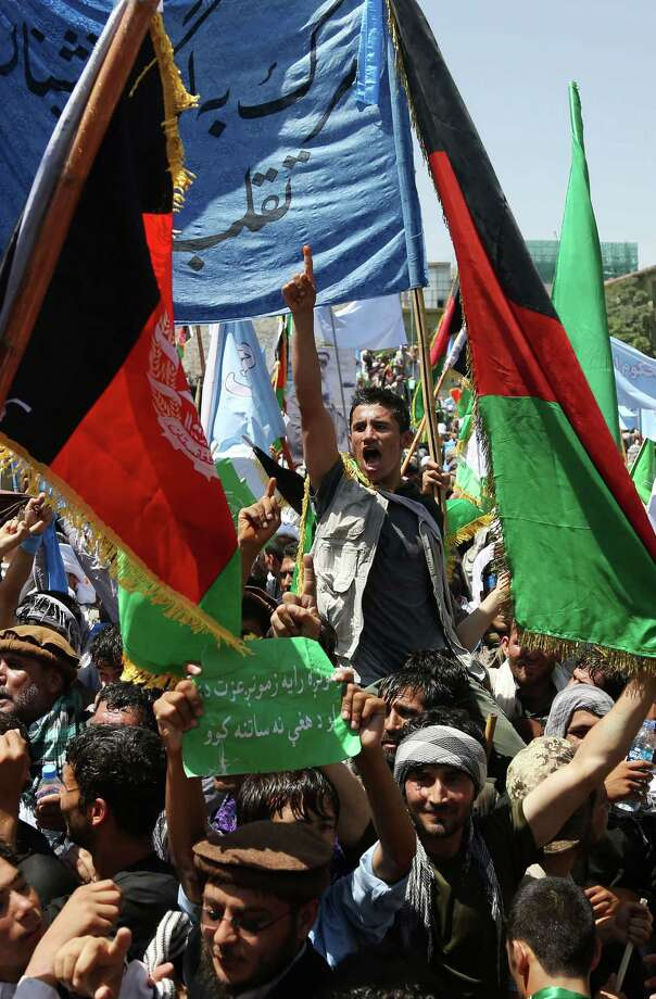 Supporters of Afghan presidential candidate Abdullah Abdullah chant slogans during a protest in Kabul, Afghanistan, Friday, June 27, 2014. Afghanistan's security situation has been complicated by a political crisis stemming from allegations of massive fraud in the recent election to replace President Hamid Karzai, the only leader the country has known since the Taliban regime was ousted nearly 13 years ago. Abdullah Abdullah, one of two candidates who competed a runoff vote on June 14 suspended his relations with the Independent Election Commission after he accused electoral officials of engineering extensive vote rigging, allegations they have denied. (AP Photo/Rahmat Gul) ORG XMIT: XRG108 Photo: Rahmat Gul / AP