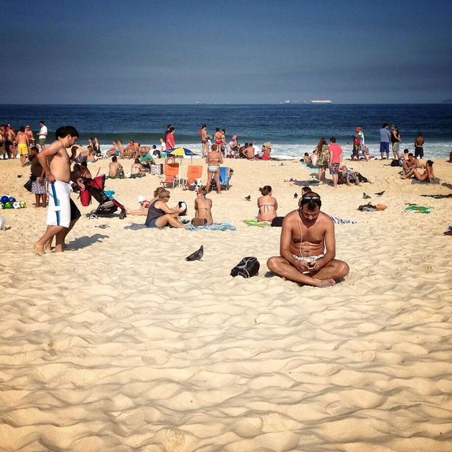 Busy in Copacabana beach in Rio de Janeiro. Photo: Wong Maye-E, Associated Press / AP