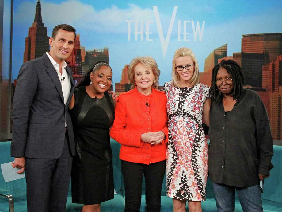 "This undated photo released by ABC shows, from left, Bill Rancic, Sherri Shepherd, Barbara Walters, Jenny McCarthy, and Whoopi Goldberg, on ""The View,"" which airs Monday-Friday (11:00 am-12:00 pm, ET) on the ABC Television Network.  Shepherd says she's leaving ABC's daytime talk show ""The View"" after seven years. In a statement Thursday, June 26, 2014, Shepherd says that after ""careful consideration"" she has decided it's time to move on.  (AP Photo/ABC, Lou Rocco) Photo: Lou Rocco, HONS / ABC"