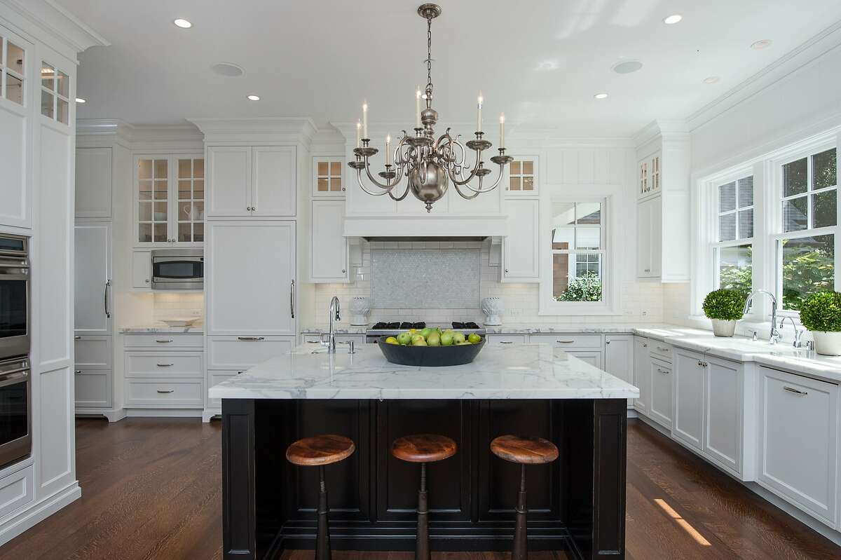 The kitchen counters are fabricated from thick slabs of marble.