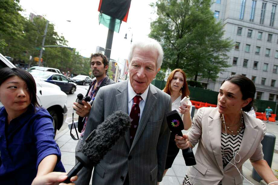 Mediator Daniel Pollack, center, leaves federal court after a hearing regarding Argentina's request to extend deadlines to repay a $1.65 billion debt to U.S. hedge funds, Friday, June 27, 2014, in New York.   Judge Thomas P. Griesa has ordered a U.S. bank to return a $539 million payment from Argentina, saying it was illegal to make. The order by the judge came Friday, three days before Argentina faces default if it fails to pay $832 million to the majority of its debt holders. (AP Photo/Jason DeCrow) Photo: Jason DeCrow, FRE / FR103966 AP