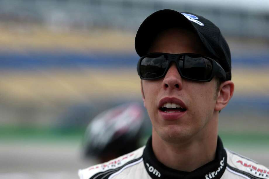SPARTA, KY - JUNE 27:  Brad Keselowski, driver of the #22 Discount Tire Ford, looks on from the grid during qualifying for the NASCAR Nationwide Series John R. Elliott HERO Campaign 300 at Kentucky Speedway on June 27, 2014 in Sparta, Kentucky.  (Photo by Todd Warshaw/Getty Images) ORG XMIT: 499587255 Photo: Todd Warshaw / 2014 Getty Images
