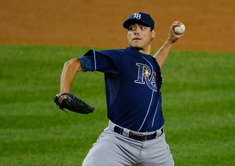NEW YORK, NY - SEPTEMBER 24:  Matt Moore #55 of the Tampa Bay Rays pitches against the New York Yankees at Yankee Stadium on September 24, 2013 in the Bronx borough of New York City.  The Rays defeated the Yankees 7-0.  (Photo by Mike Stobe/Getty Images) Photo: Mike Stobe, Getty Images