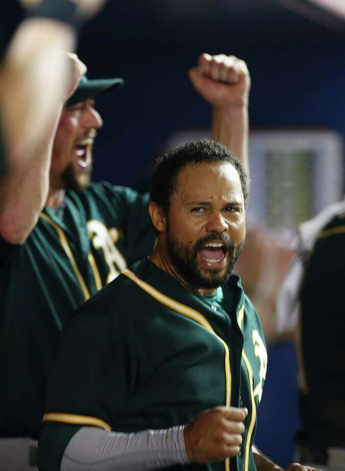 Oakland Athletics player Coco Crisp reacts after a video review showed he scored the go-ahead run during the ninth inning of a baseball game in Miami against the Miami Marlins, Friday, June 27, 2014. The A's won 9-5. (AP Photo/J Pat Carter) ORG XMIT: FLJC111 Photo: J Pat Carter / AP