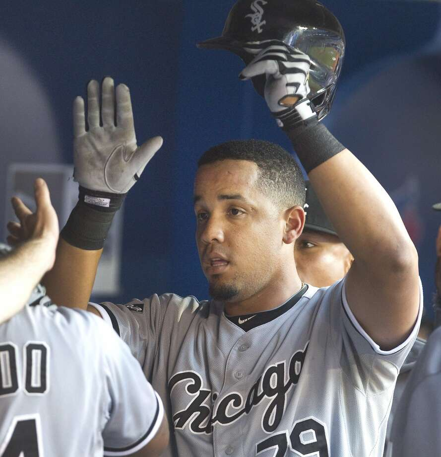 Chicago White Sox's Jose Abreu is congratulated in the dugout after he hit a solo home run off Toronto Blue Jays starting pitcher R.A. Dickey during the fifth inning of a baseball game in Toronto on Friday, June 27, 2014. (AP Photo/The Canadian Press, Fred Thornhill) Photo: Fred Thornhill, Associated Press