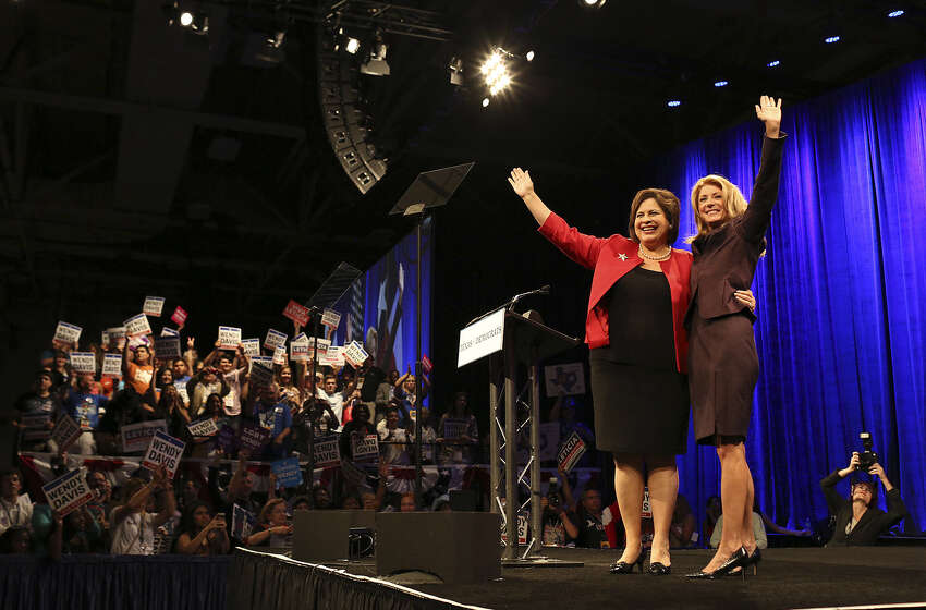 Lieutenant governor hopeful Leticia Van de Putte of San Antonio joins Wendy Davis of Fort Worth on stage after the governor candidate's address to the Democratic convention.