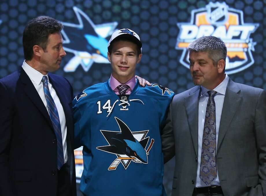 Nikolay Goldobin, flanked by general manager Doug Wilson (left) and coach Todd McLellan, was the Sharks' top pick. Photo: Bruce Bennett, Getty Images