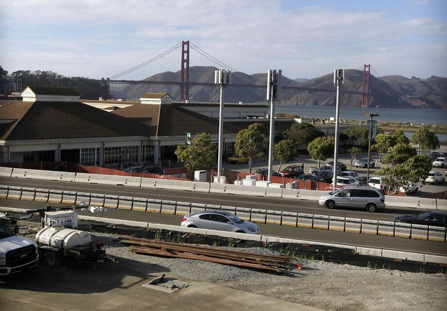 The Presidio Trust says there are no imminent plans to demolish the old Army commissary occupied by the Sports Basement on San Francisco's waterfront. Photo: Paul Chinn, The Chronicle