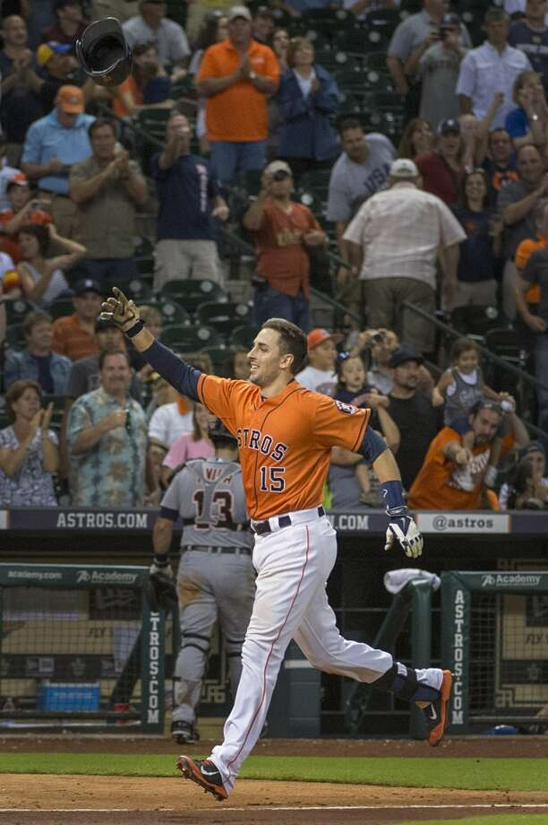 Jason Castro tosses his helmet as he heads for home after hitting a walkoff home run in the 11th inning. Photo: Smiley N. Pool, Houston Chronicle