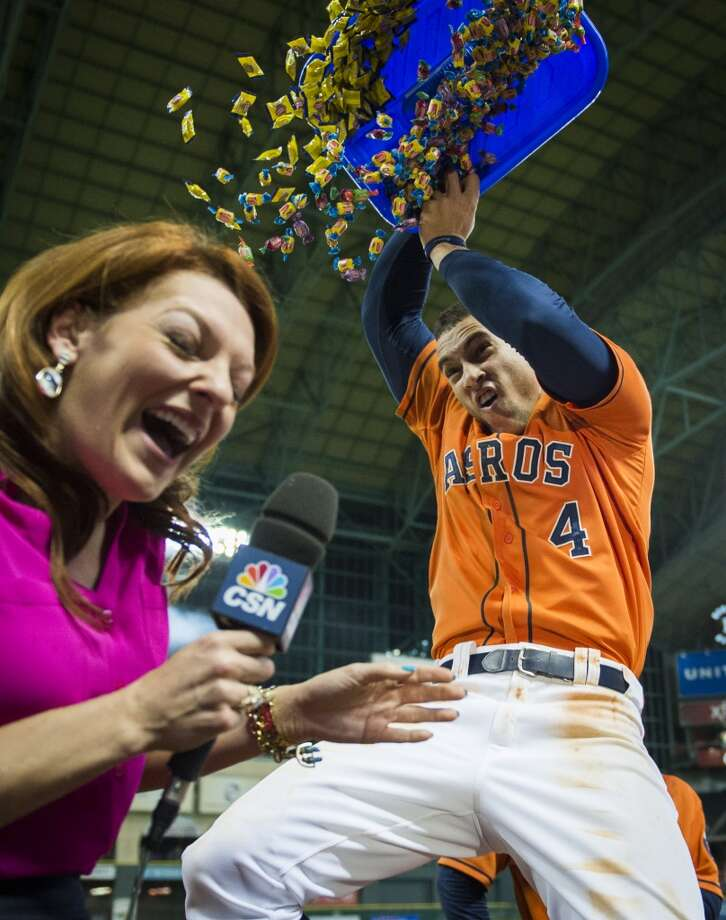 George Springer dumps a bucket of bubble gum on Julia Morales, the Astros field reporter for Comcast SportsNet Houston, as the team celebrates a 4-3 victory over the Detroit Tigers. Photo: Smiley N. Pool, Houston Chronicle