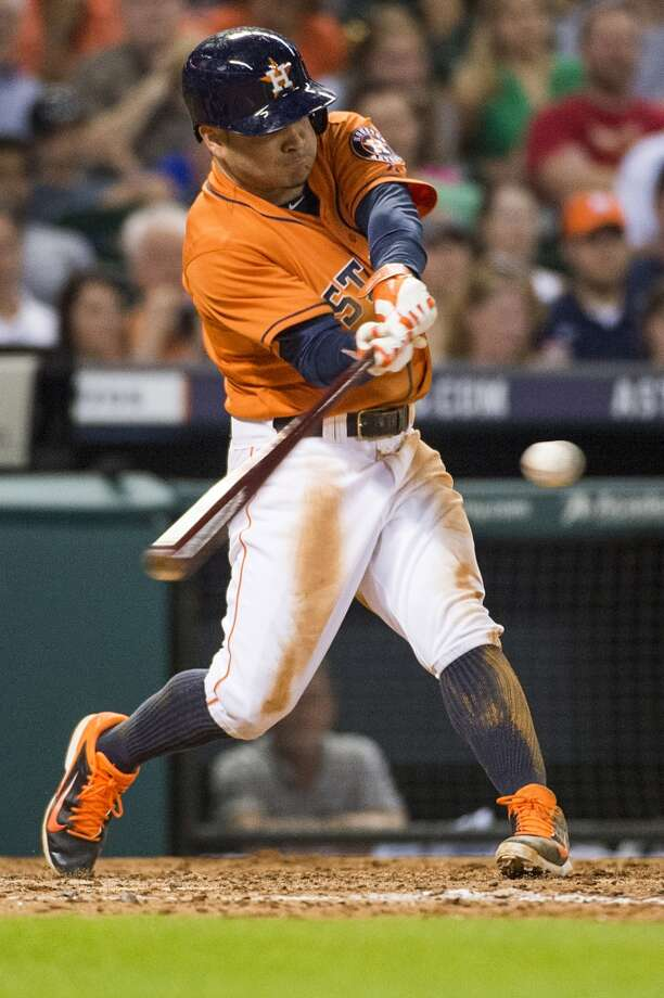 Astros second baseman Jose Altuve drives in a run with a double during the fifth inning. Photo: Smiley N. Pool, Houston Chronicle