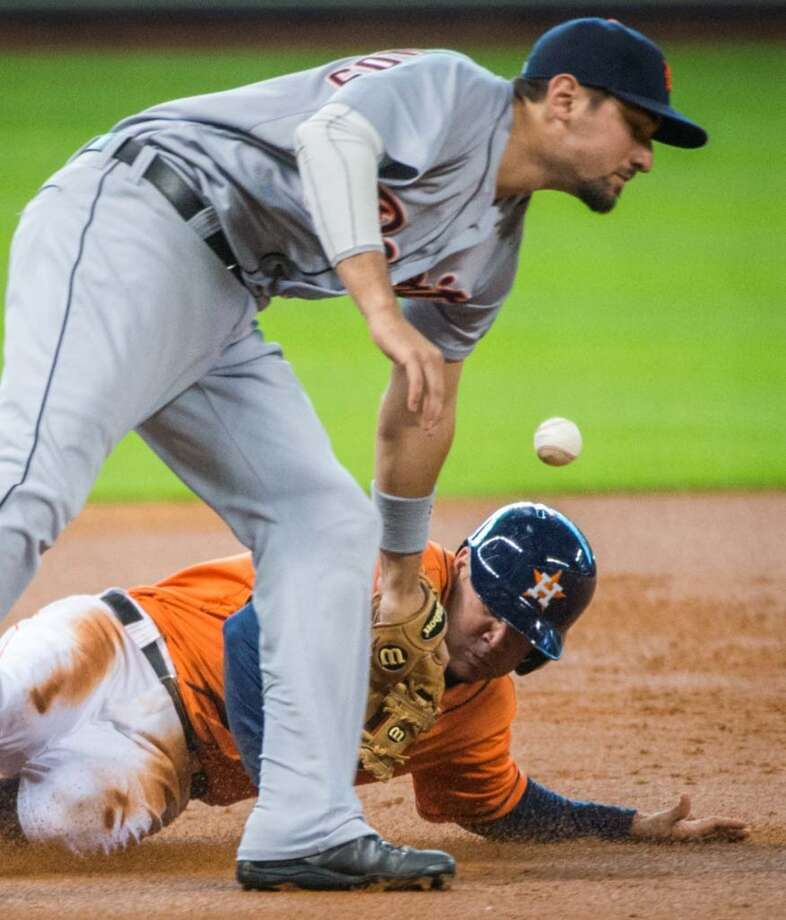 Astros second baseman Jose Altuve is safe at third base as the throw gets past Tigers third baseman Nick Castellanos. Photo: Smiley N. Pool, Houston Chronicle
