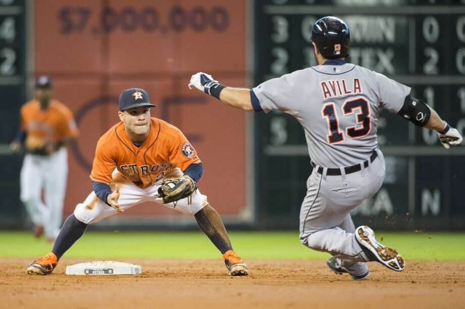 Astros second baseman Jose Altuve waits to put the tag on Tigers catcher Alex Avila as he is thrown out trying to stretch a double during the second inning. Photo: Smiley N. Pool, Houston Chronicle