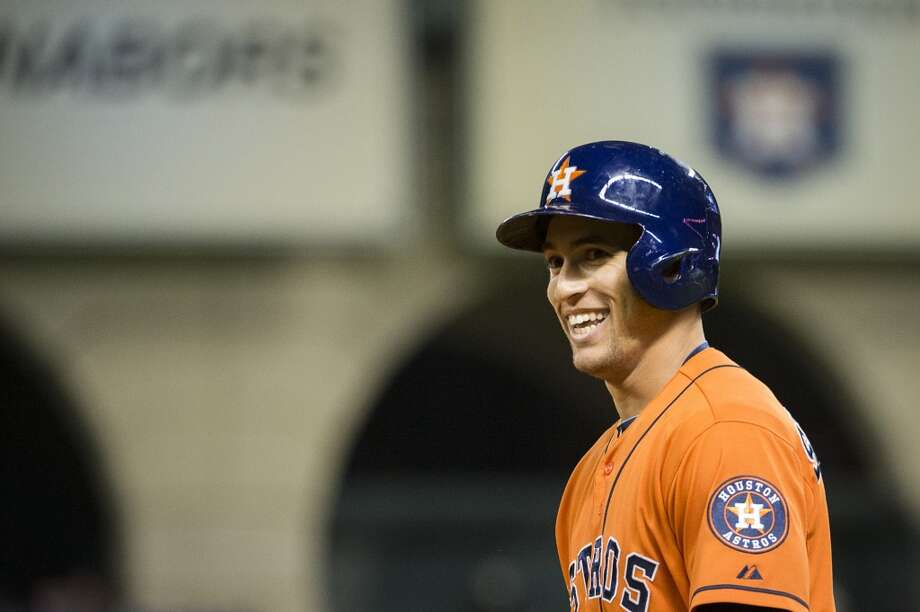 Astros right fielder George Springer smiles after beating out an infield single during the fifth inning. Photo: Smiley N. Pool, Houston Chronicle