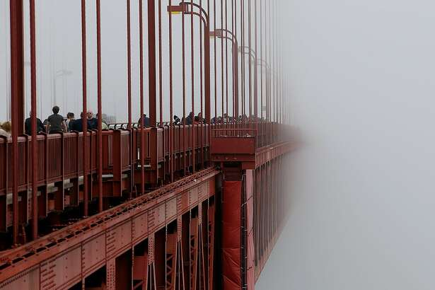 SAN FRANCISCO, CA - JUNE 27: The span of the Golden Gate Bridge disappears into the fog on June 27, 2014 in San Francisco, California. The Golden Gate Bridge district's board of directors voted unanimously to approve a $76 million funding package to build a net suicide barrier on the iconic span. Over 1,500 people committed suicide by jumping from the iconic bridge since it opened in 1937. 46 people jumped to their death in 2013. (Photo by Justin Sullivan/Getty Images) *** BESTPIX ***