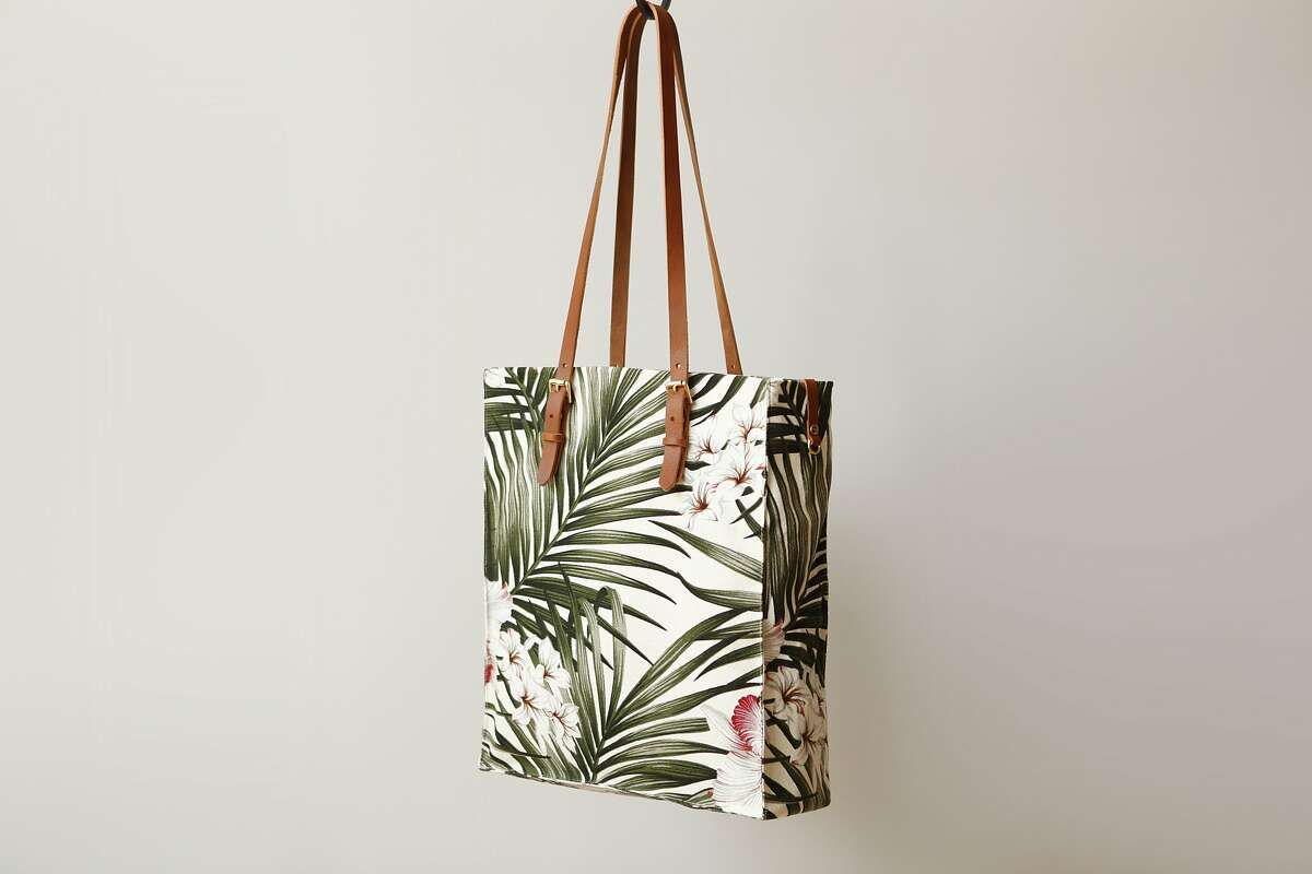 """Handcrafted in San Francisco and made from soft and slightly textured 100 percent cotton Hawaiian barkcloth, the Presidio Palms Tote Tote ($175, www.futureglory.co) measures 13""""L x 15""""W x 4""""H and features leather straps with adjustable brass buckles and reinforced stitching for durability."""