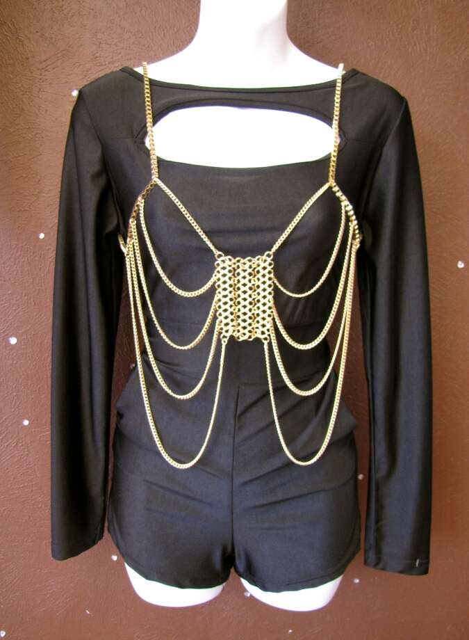 Black cutout romper, $39.99; Body chain, $23.99.  Sparkle and Charm, Beaumont Photo: Larena Head/cat5