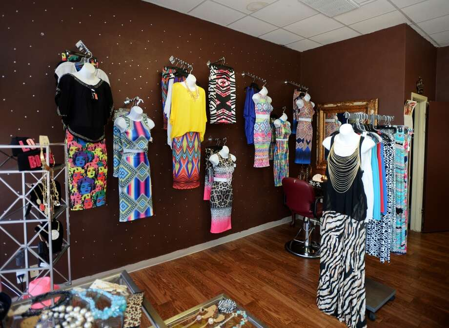 Clothing hangs on a wall and on the racks at Sparkle and Charm Boutique and Spa on Thursday afternoon. Monica Mishaw owns and operates Sparkle and Charm Boutique and Spa, located in West Brook Shopping Center on Calder Avenue. The shop has been serving customers for a little over two months. Photo taken Thursday, 4/24/14 Jake Daniels/@JakeD_in_SETX