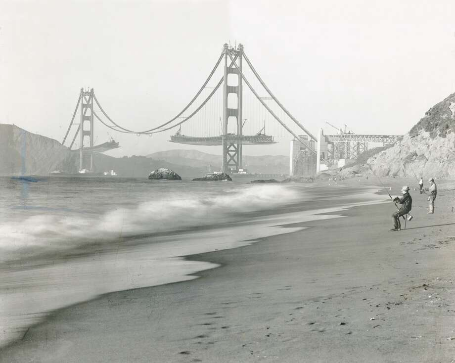 Final stage of construction with decks being extended outward from both Golden Gate Bridge towers. Photo: Chronicle Archives, Tidewater Associated Oil Co.