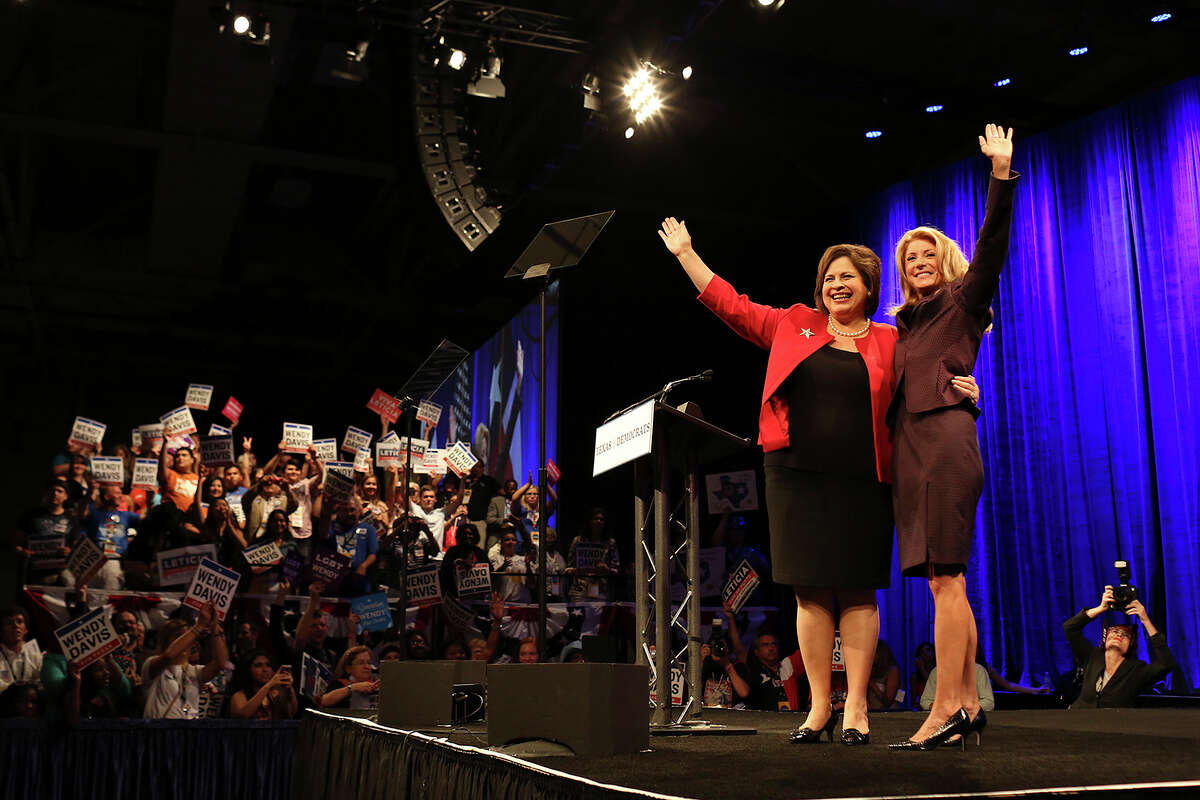 State Senator and candidate for Lt. Governor Leticia Van de Putte, left, and State Senator and candidate for Governor Wendy Davis join together on stage after Davis' speech during the Texas Democratic State Convention at the Dallas Convention Center in Dallas on Friday, June 27, 2014.
